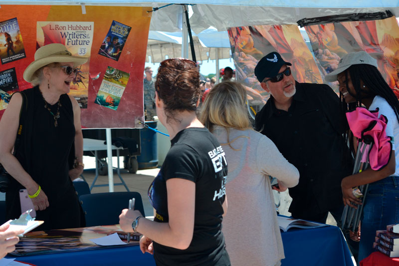 Signing books for fans at Barksdale Air Show