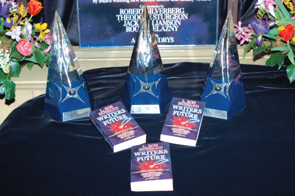 The First Place trophies and the newly released Volume I of L. Ron Hubbard Presents Writers of the Future.
