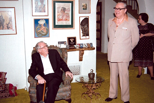 "Forrest J. Ackerman gives a tour of his famous ""Ackermansion."" Jack Williamson, seated."