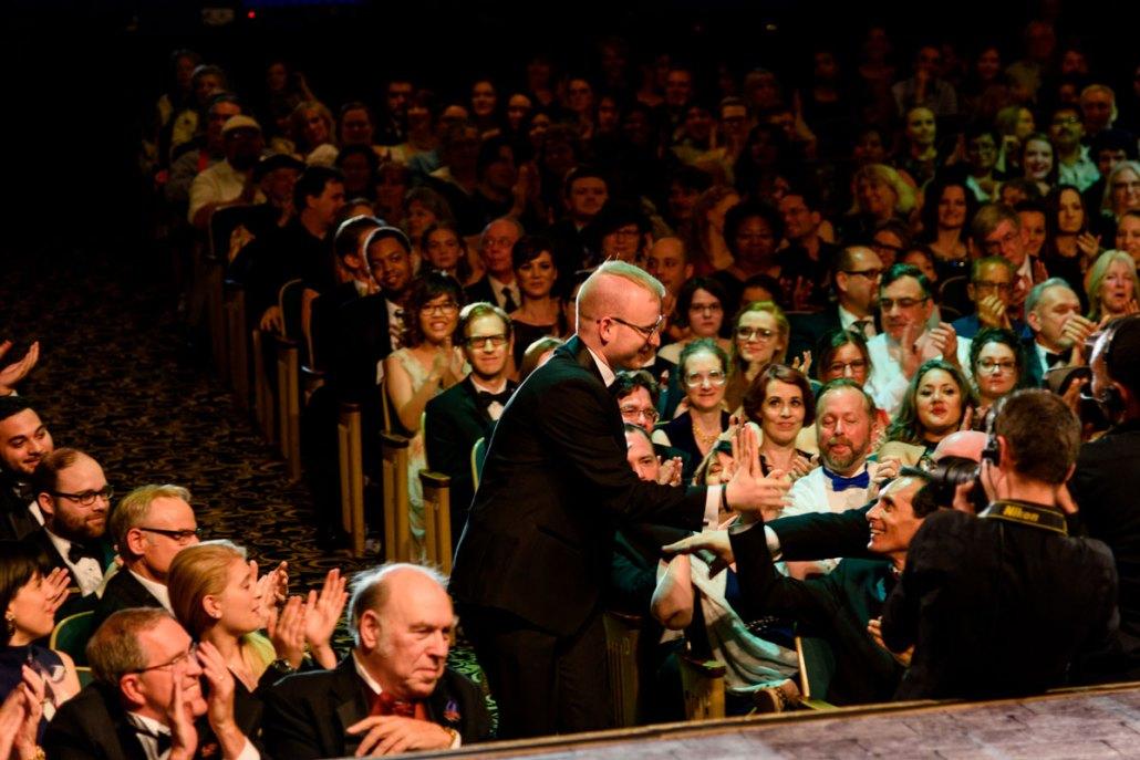 Michael being congratulated by artist Ciruelo on winning the Golden Brush Award