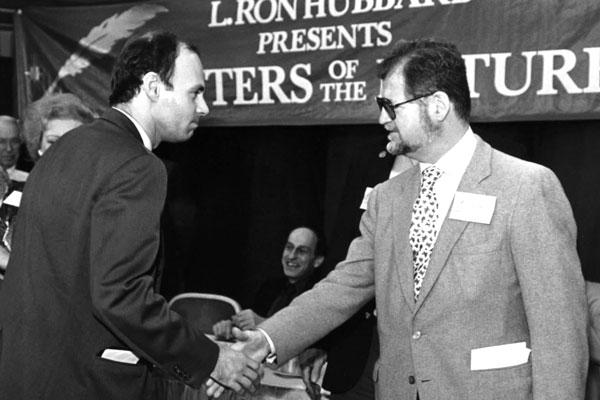 Larry Niven (R) congratulating winner J.R. Dunn