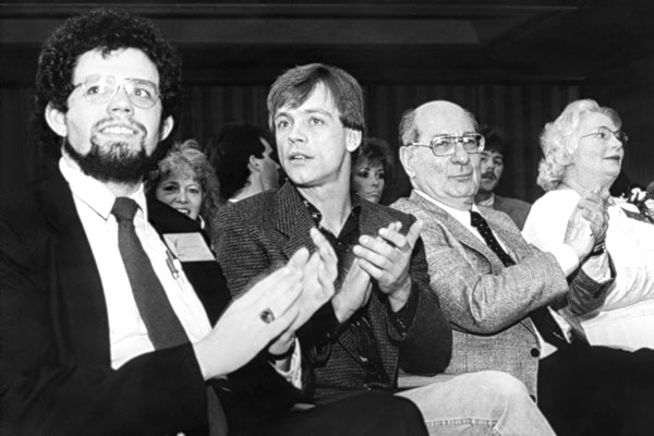 Warner Books editor Brian Thomsen, actor Mark Hamill, DC Comics editor Julius Schwartz, and Rosemary Wolfe applaud the winners.