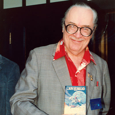 Forrest J. Ackerman shows off his new copy of Writers of the Future Volume 4.