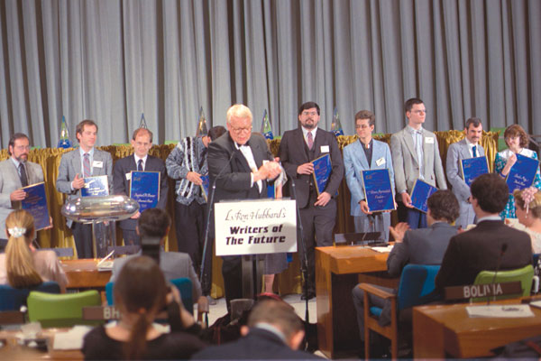 Winners pose for photos in the Trusteeship Council Chamber.