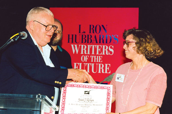 Susan J. Kroupa receives her workshop completion certificate from Algis Budrys.