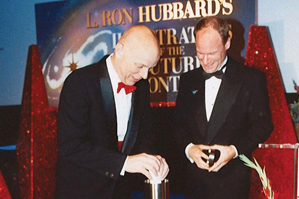 Story Musgrave and MC Jim Meskimen prepare the time capsule.