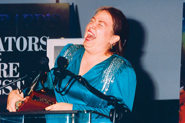 Arlene C. Harris is ecstatic to receive her Gold Award.