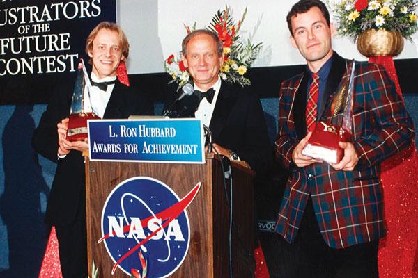 Gold Award winners, Illustrator Eric Williams and Writer Morgan Burke with Norman Thagard.
