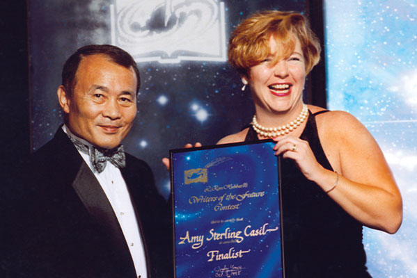 Amy Sterling Casil on stage with Dr. Yoji Kondo.