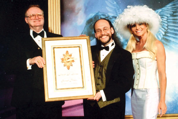 David D. Levine receives his Second Place Award from Dr. Jerry Pournelle and actress Julie Michaels