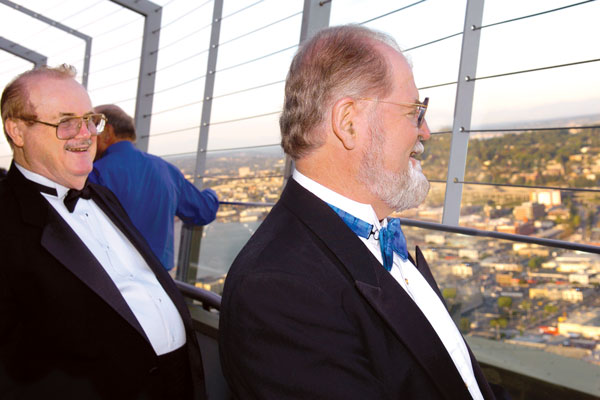 Dr. Jerry Pournelle and Larry Niven look out at Seattle from the Space Needle's observation deck.