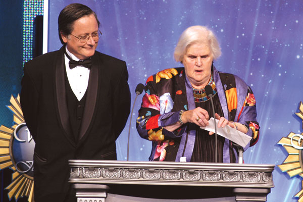 Anne McCaffrey opens the envelope to announce the winner of the Gold Award.