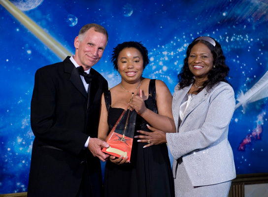Ron Lindahn and Dr. Sandra Johnson present Brittany J. Jackson with the Golden Brush Award