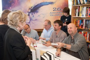 Writer winners and judges signing books at Borders Bookstore.