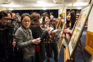 Illustrators present their art to the writers. Chinese media attended to cover this year's Taiwanese winners.
