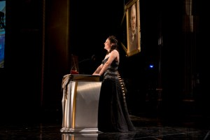 Golden Pen Award Winner Tina Gower on stage.