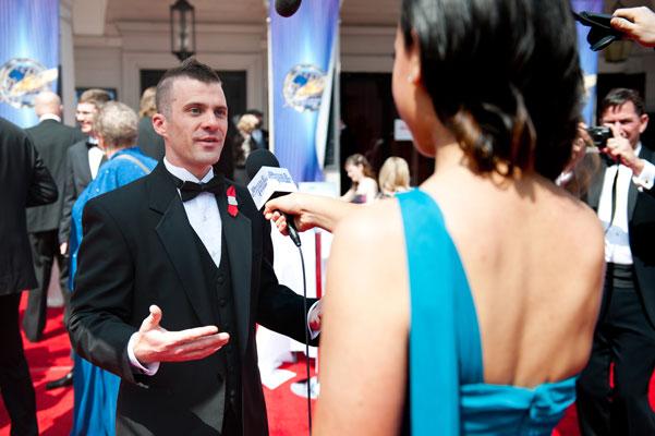 Illustrator Golden Brush Award Winner Trevor Smith being interviewed on the red carpet.