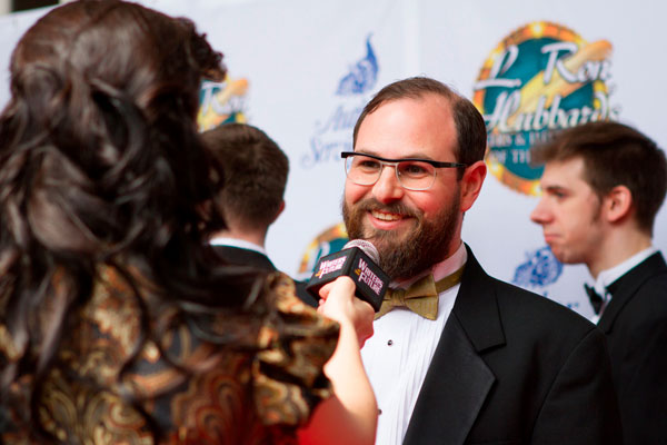 Writer winner Jon Lasser being interviewed on the red carpet.