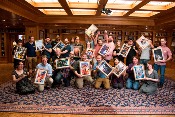 Illustrators and writers meet up with the art created for their stories.