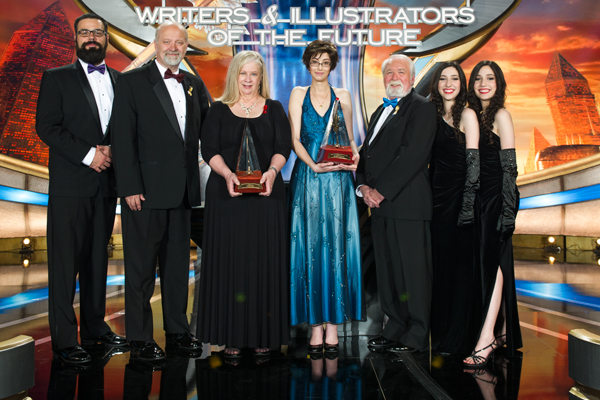 William Pomerantz (far left) with David Farland, Sharon Joss, Michelle Lockamy, Larry Elmore and the Winner Twins at the Annual Awards Celebration