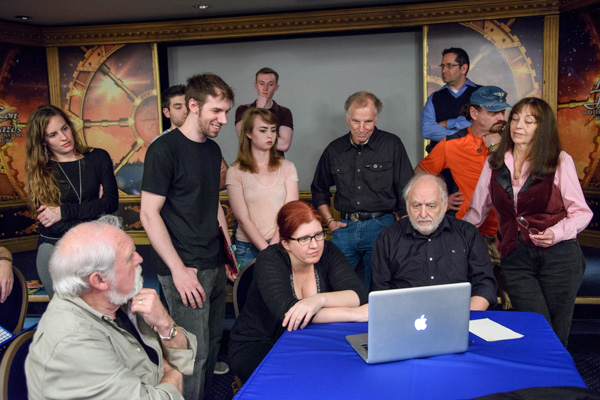 Illustrator judges doing winner portfolio reviews. seated: Larry Elmore, Echo Chernik, Bob Ciano. Standing: Ron Lindahn, Sergey Poyarkov and Val Lindahn.