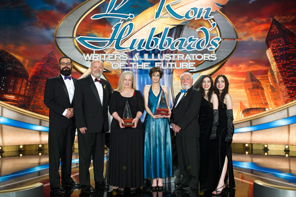 Sharon Joss and Michelle Lockaby (center) with award presenters: (l to r) William Pomerantz, VP Virgin Galactic, David Farland, Larry Elmore with Brittany and Brianna Winner.