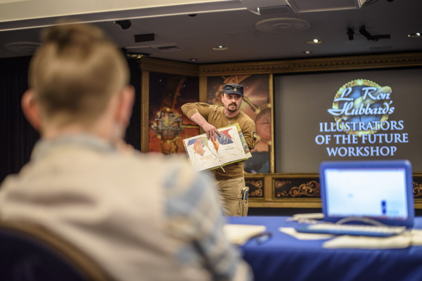 Sergey Poyarkov speaking to the illustrator winners.