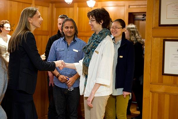 Gunhild Jacobs from Author Services greets Illustrator Michelle Lockamy while Illustrator Amit Dutta looks on.