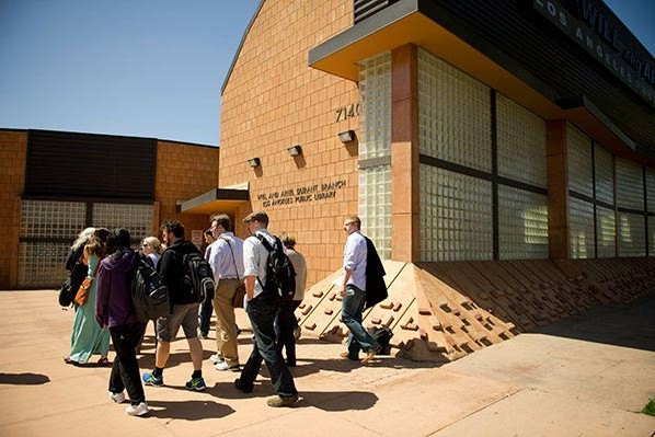 Writers going to LA Public Library to pick up books in preparation for their 24-hour stories.