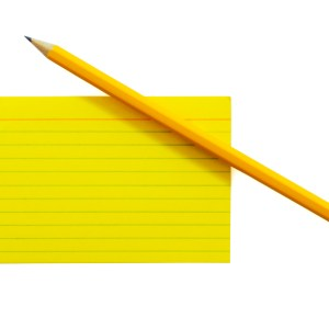 Yellow index card and pencil