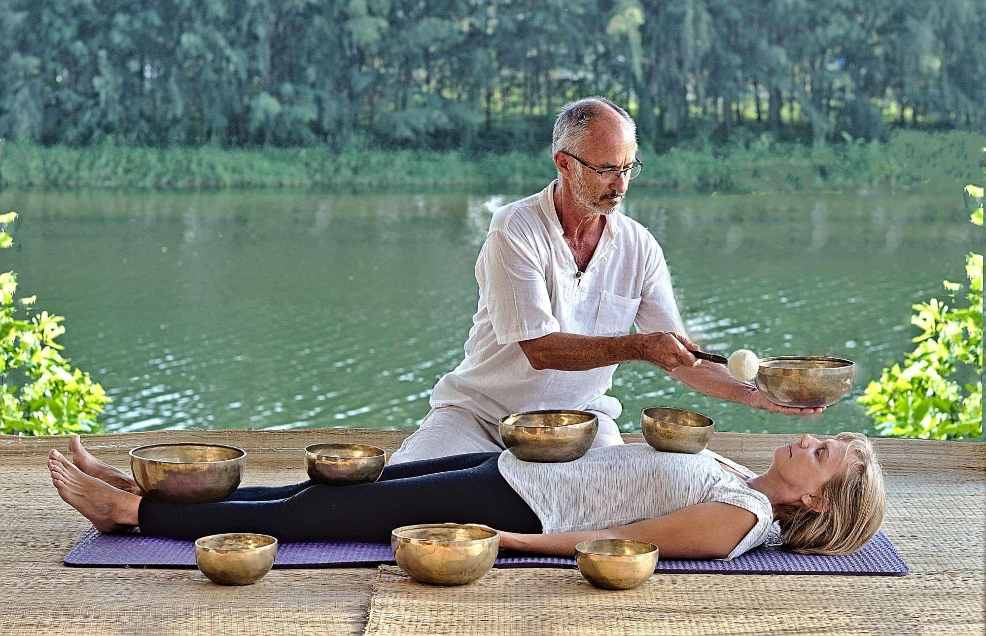 Meditation Retreat Vietnam - Write Your Journey: Nigel Rowles gives Kerstin Pilz a relaxing sound bowl treatment