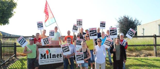 Milnes Foods workers who are SIPTU trade union members on strike during sunnier weather in the summer of 2013