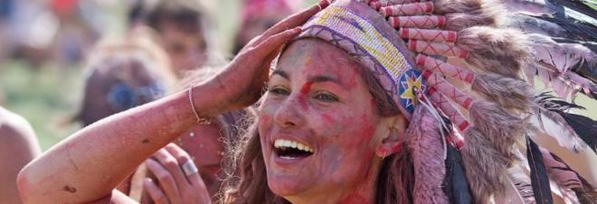 Skin painted red, wearing feather headdress, this girl at Glastonbury is as offensive to Native Americans as blacking up pretending to be African would be