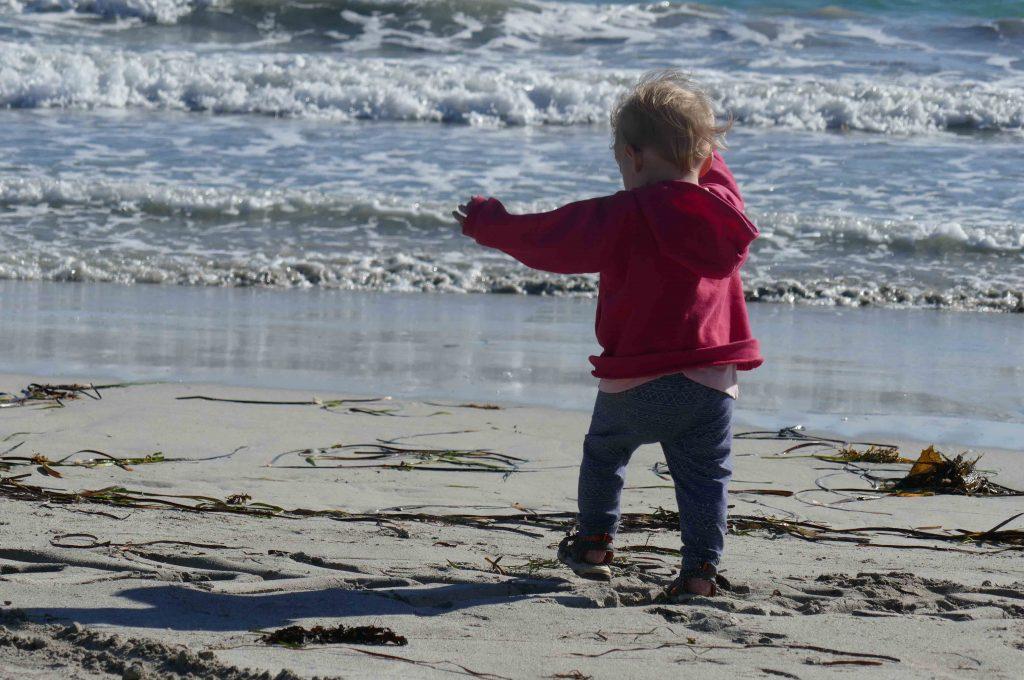 https://www.writteninwaikiki.com/the-art-of-saying-no/ child walking beach ocean