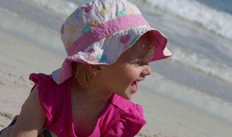 https://www.writteninwaikiki.com/things-i-want-my-daughter-to-know/ daughter girl child laughing beach