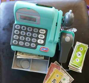 https://www.writteninwaikiki.com teach your child the value of money kids toy play money and cash register