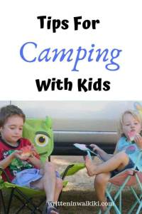 tips for camping with kids pinterest kids sitting on camp chairs while camping
