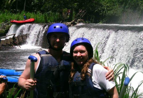 waterfall couple after white water rafting