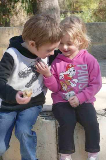 kids siblings hugging taking a moment