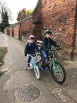 Darcey and Max ride their bikes