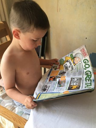 Jack reads about Greta in National Geographic