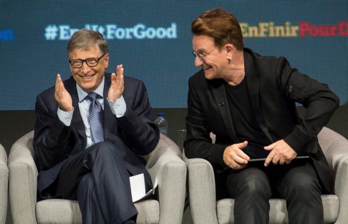 Billionaire philanthropist Bill Gates and Bono exchange laughs during a session at the Global Fund conference Saturday, Sept. 17, 2016 in Montreal. (Paul Chiasson/The Canadian Press via AP)