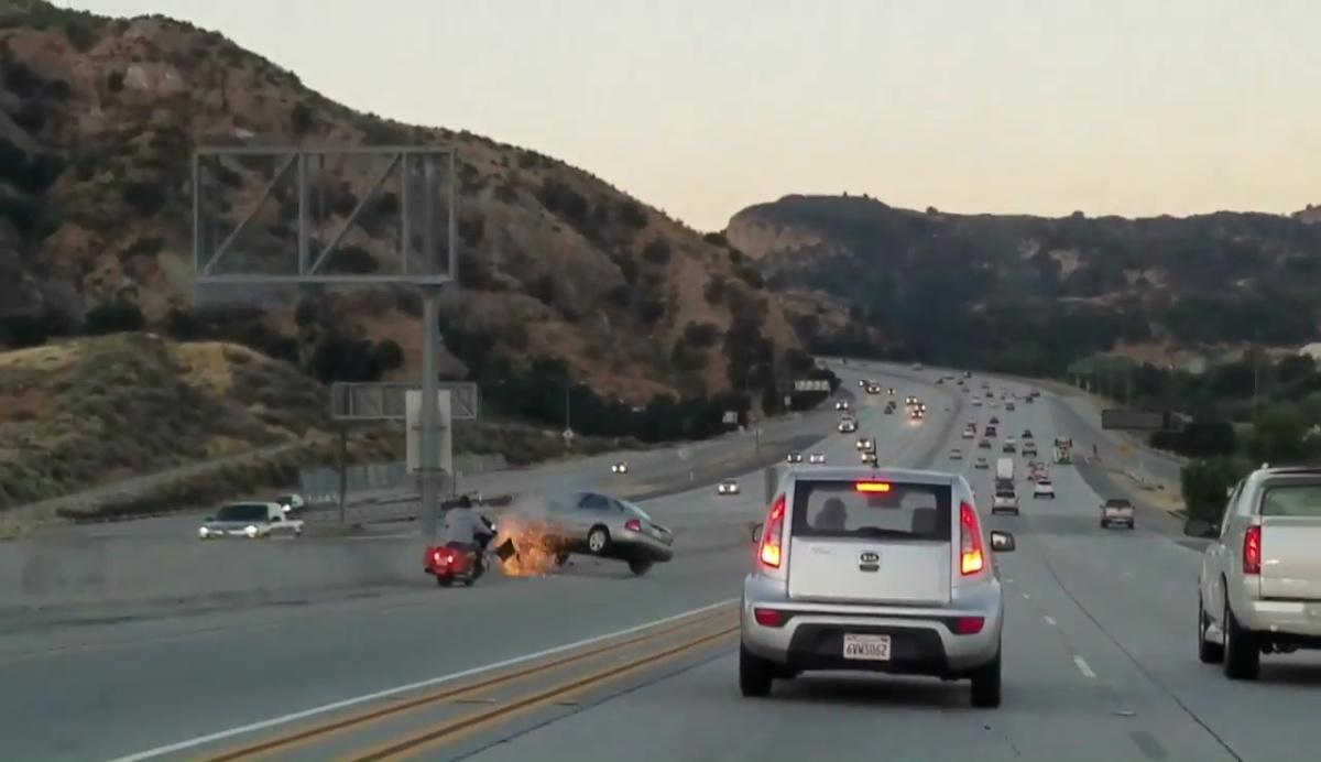 motorcyclist kicks car_406860
