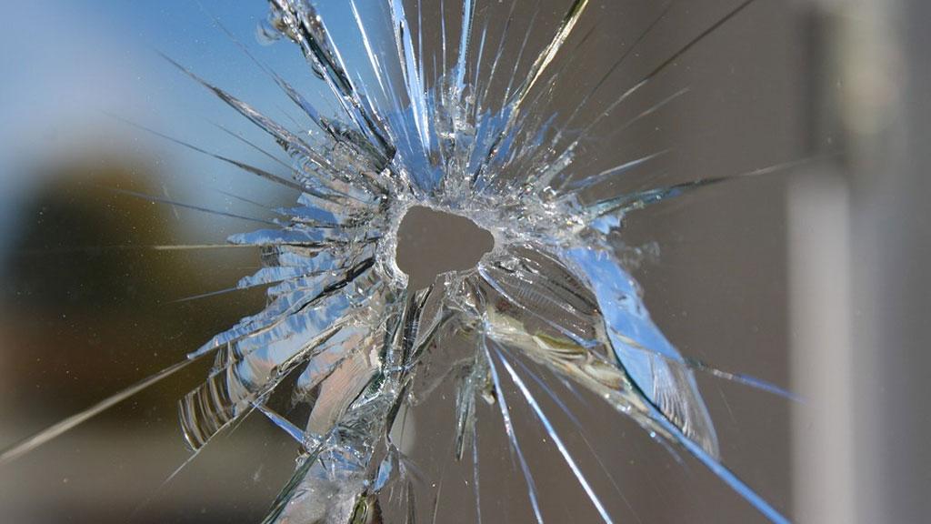 bullet-hole-in-window_1542036626653.jpg