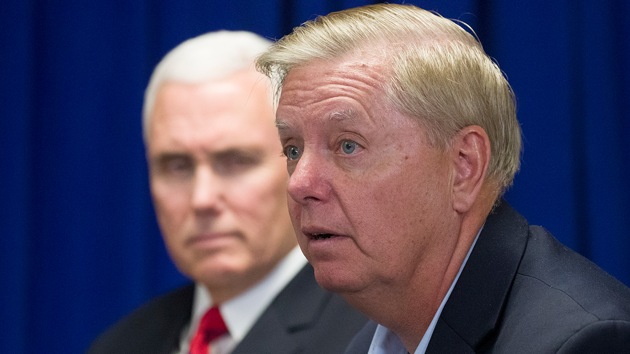 Lindsey Graham and Mike Pence  _1552869212242.jpg.jpg
