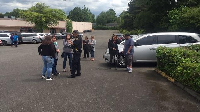 Parkrose High School shooting parents parking lot 05172019_1558121756251.jpg_87962356_ver1.0_640_360_1558123063642.jpg.jpg