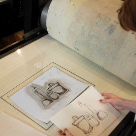 Kingston High School participant proofing her drypoint plate