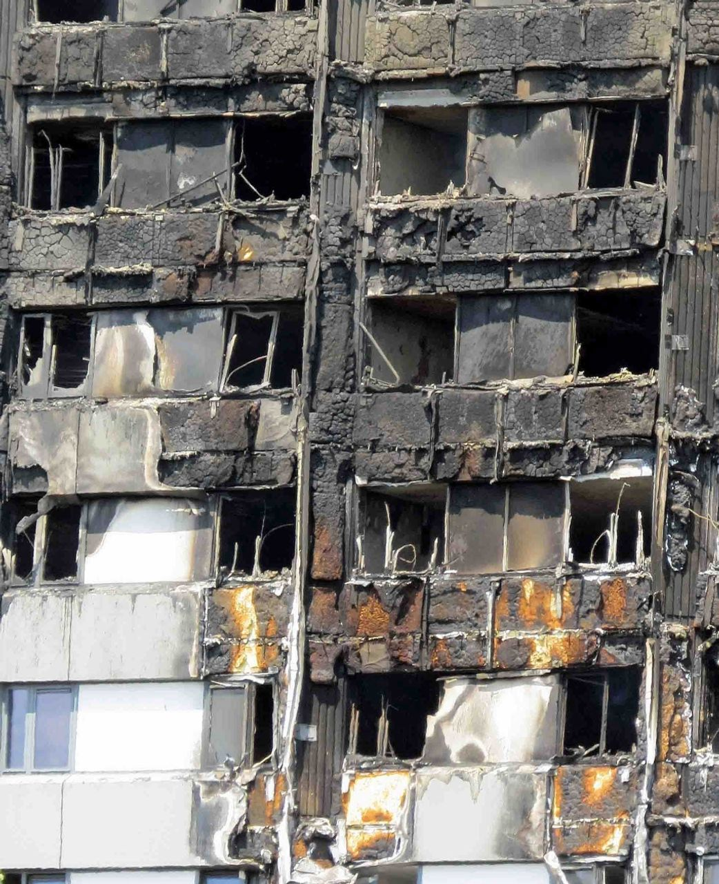 Photo showing the remains of the burnt away Grenfell Tower foam and aluminium cladding
