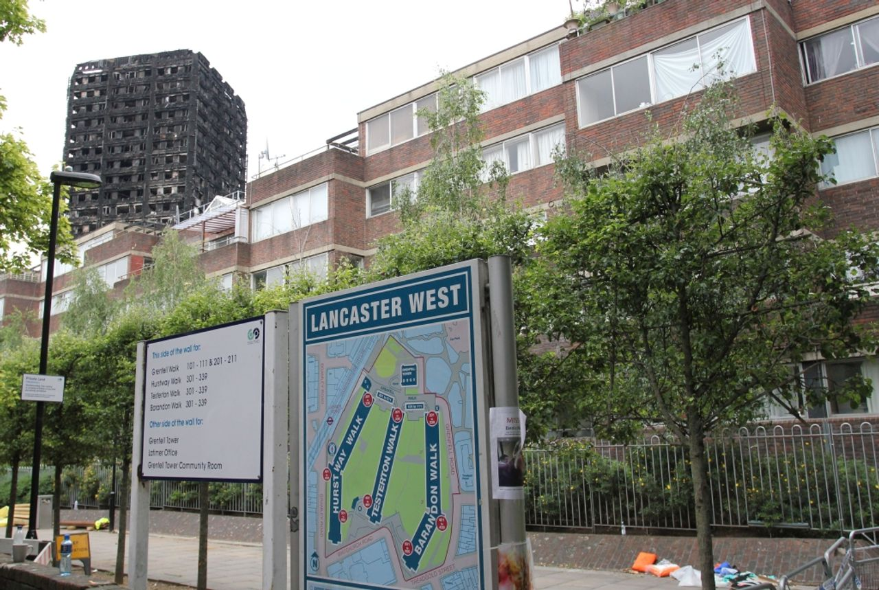 Social housing on the London Lancaster West housing estate with the destroyed Grenfell Tower behind