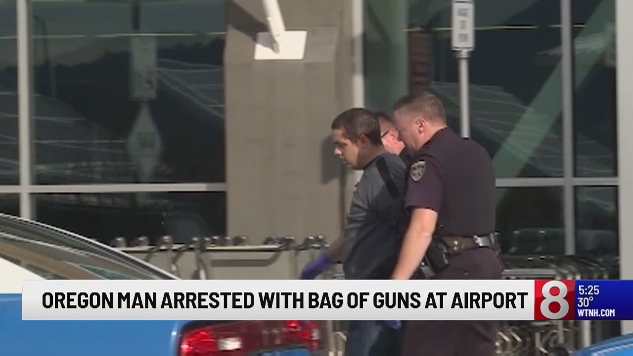 Armed man arrested after scuffle at Medford airport